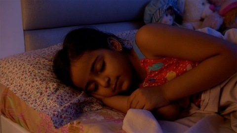 Cute little child girl sleeping in a bedroom at night.  Sweet dreams. Childhood concept