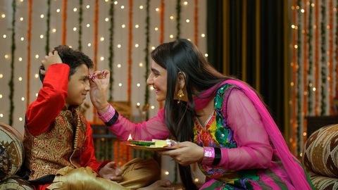 Happy brother sister celebrating Raksha Bandhan / Bhai Dooj festival
