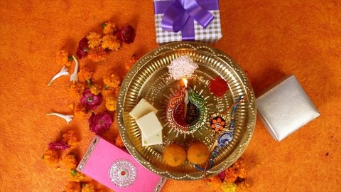 Top view of a decorated puja thali for Raksha Bandhan celebrations - Indian festival