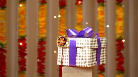 Tilt shot of various Raksha Bandhan items placed on one another - Indian festival