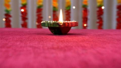 Tilt up shot of a burning diya on the occasion of Raksha Bandhan or Diwali