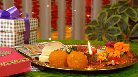 Pan left to right shot of a decorated puja thali - Raksha Bandhan festival