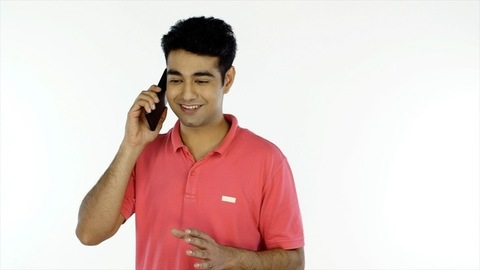 The middle-aged man happily talking to his friend over a phone call - technology concept