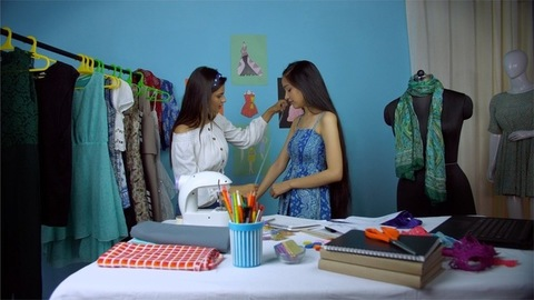 Young fashion entrepreneur confidently working at her self owned boutique