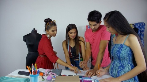 Group of young Indian students engaged in fashion studies workshop - Learning from a successful designer