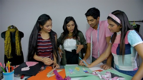 Young fashion designer teaching a topic related to fashion studies to her students