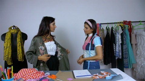 Young businesswoman discussing the dress pattern and style with her customer