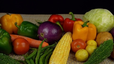 Pan shot of different organic vegetables on a kitchen mat - healthy and vegetarian food