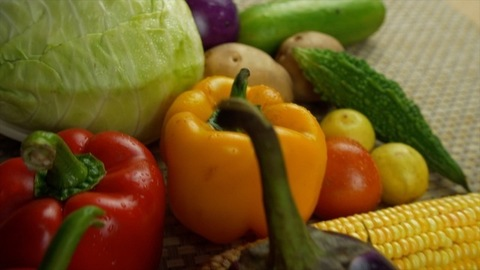Tilt shot of a pile of different raw vegetables on a kitchen mat - Fresh veggies