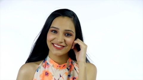 Beautiful Indian girl showing off herself with a wide toothy smile - lifestyle concept