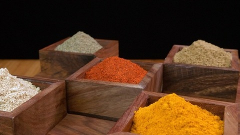 Collection of Indian spices in a vintage wooden container - common spices produced in India