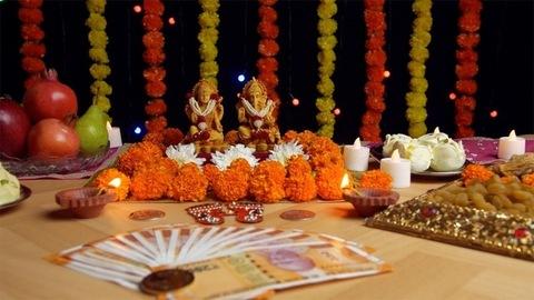 Pan shot of Hindu Gods Laxmi Ji and Ganesh Ji for Diwali puja - the festival of India