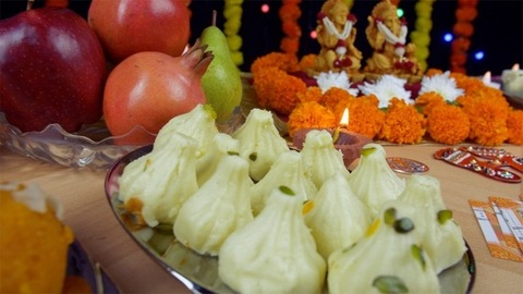 Moving shot of Indian gods Laxmi and Ganesh on the festival of lights - Diwali