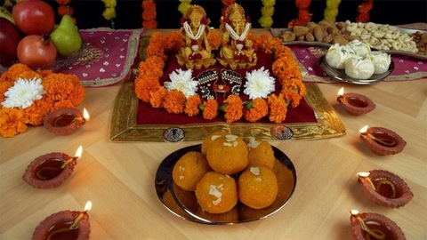 Moving shot of a decorated temple/ mandir with Ganesh Ji and Lakshmi Ji for Diwali Puja