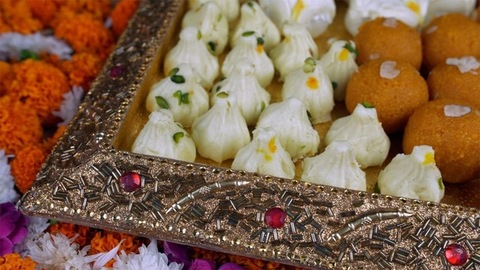 Closeup shot of mix mithai served in a beautiful silver tray on the festival of Diwali