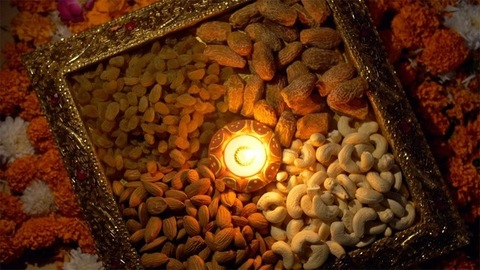 Indian festival Diwali celebration - a designer tray containing dry fruits rotating on a turntable