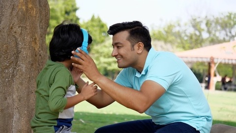 Young handsome father enjoying the weekend with his son - Indian family concept