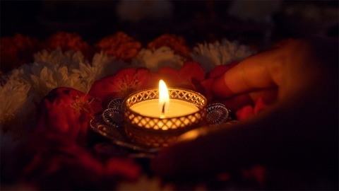Hands of an Indian female doing decorations for Diwali - the festival of India