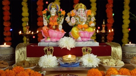 Tilt shot of Laxmi Ganesh Idols with decorated puja thali on the festival of Diwali