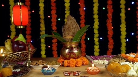 Moving shot of a copper Kalash with coconut and mango leaves for Diwali - Indian festival