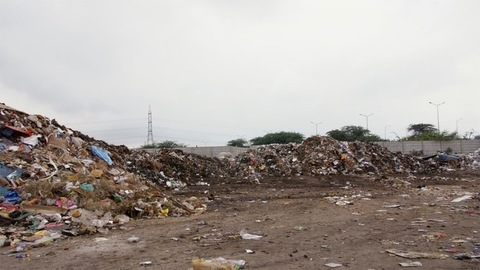 Pile of domestic or household waste in a dumping ground - pollution and ecology concept