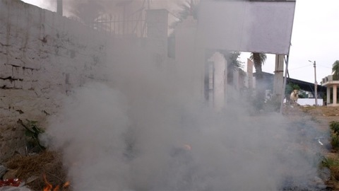 Air pollution from burning household waste on the sides of a road - bad ecology concept