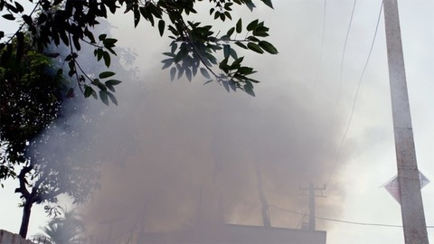 A burning garbage dump polluting harmful smoke in the environment - air pollution