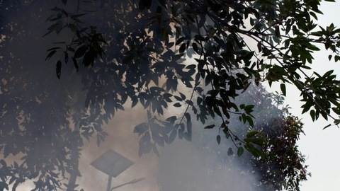 Smoke emission from a factory polluting environment in India - air pollution concept