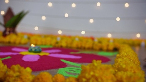 Bokeh shot of a colorful rangoli decorated with flower garlands on the festival - Diwali/Dipavali