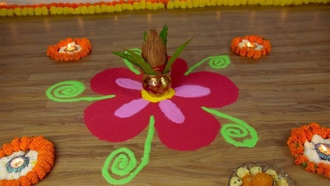 Tilt shot of rangoli made with colored powders on the floor for Diwali - the festival of India