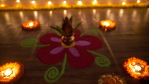 Bokeh shot of a decorated rangoli in dark with festive background - Diwali festival