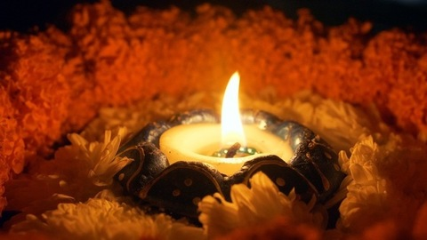 Closeup shot of a burning oil lamp on a floral platform decorated for Diwali - Indian festival